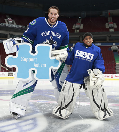 Vancouver Canucks goaltender Jacob Markstrom and a goaltender from our I CAN Play Hockey program.