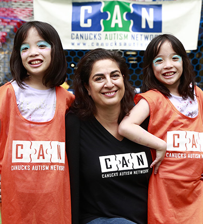 CEO Katy Harandi with two children with autism at our annual Sports Day.