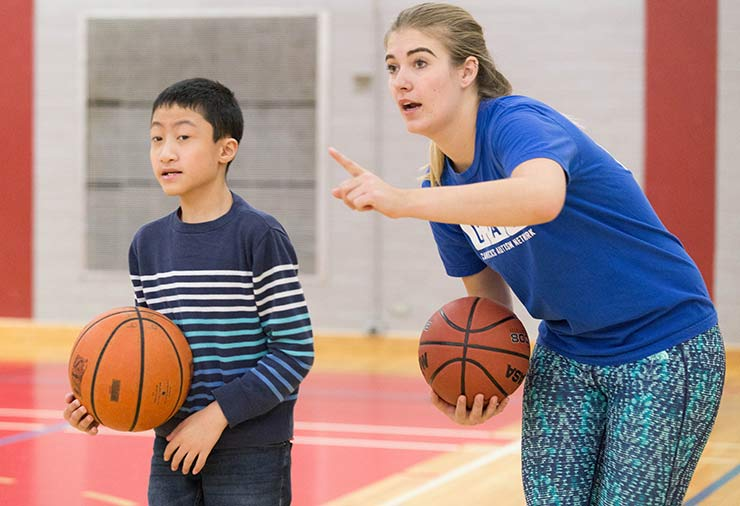 A child with autism and a support worker in our I CAN Play Sports program