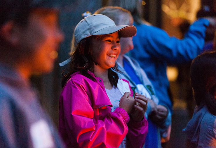 A child with autism smiling at our Overnight Camp program.
