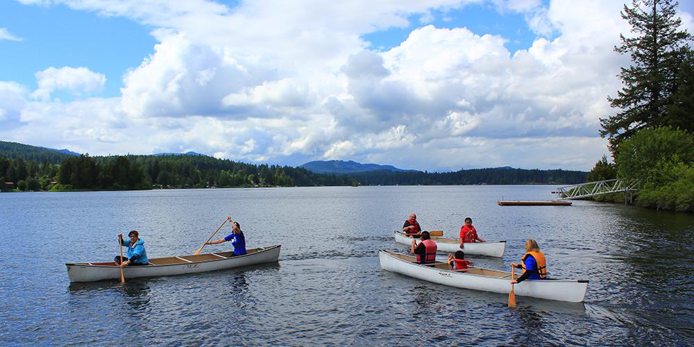 Three canoes on a lake