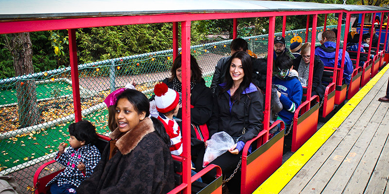 CAN participants and parents enjoying a ride on a miniature train.