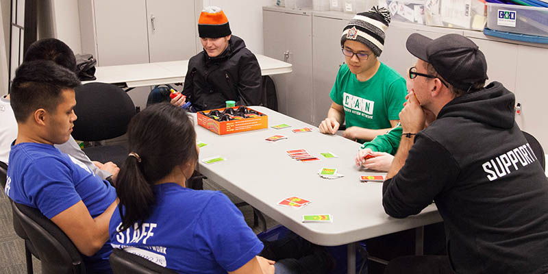 A group of people playing a board game.